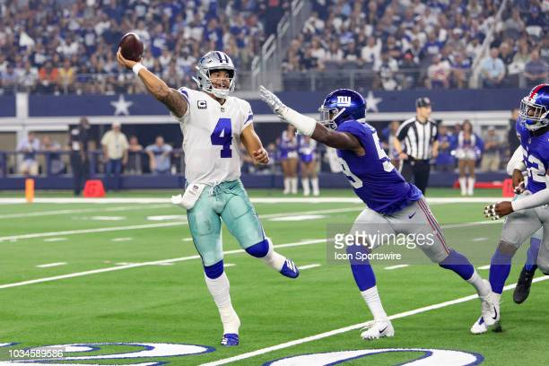 Dallas Cowboys quarterback Dak Prescott throws a pass during the game between the New York Giants and Dallas Cowboys on September 16 2018 at ATT...