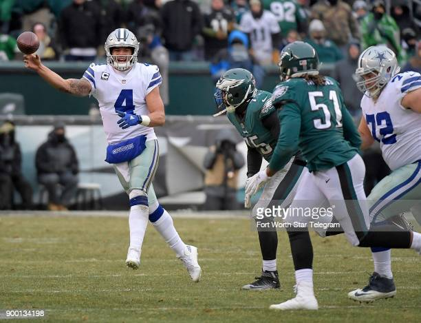 Dallas Cowboys quarterback Dak Prescott throws on the run as Philadelphia Eagles defensive ends Vinny Curry and Steven Means chase at Lincoln...