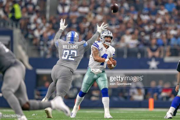 Dallas Cowboys quarterback Dak Prescott throws while being pressured by Detroit Lions defensive tackle Sylvester Williams during the game between the...