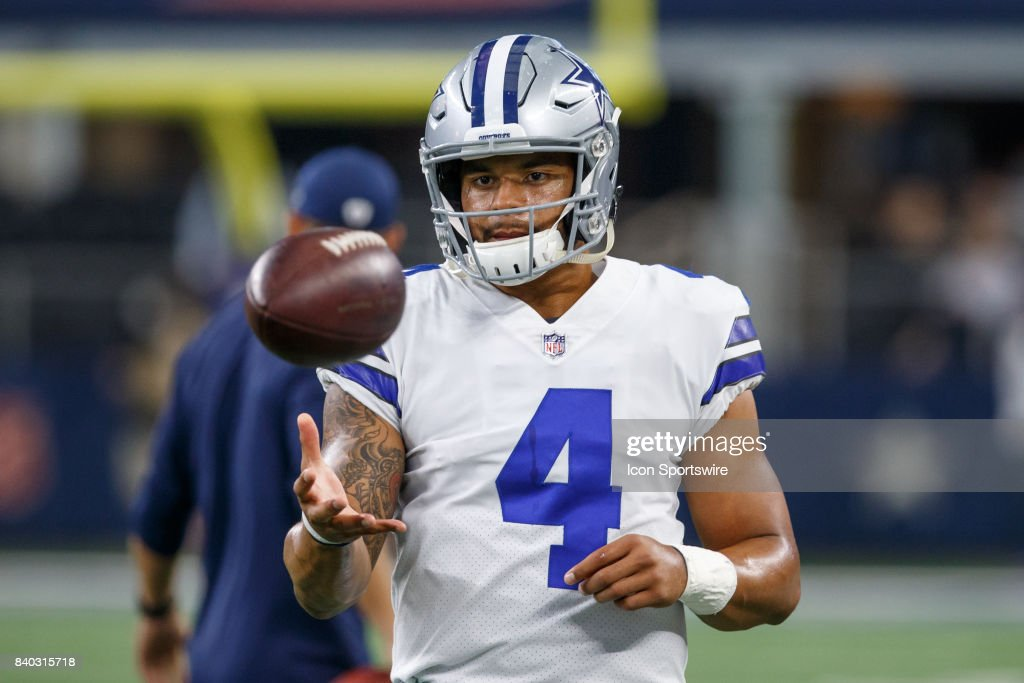 Dallas Cowboys quarterback Dak Prescott (#4) warms up during the NFL preseason game between the Dallas Cowboys and Oakland Raiders on August 26, 2017 at AT&T Stadium in Arlington, Texas.
