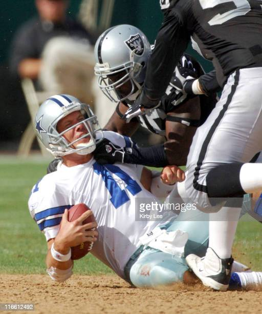 Dallas Cowboys quarterback Drew Bledsoe is sacked by Oakland Raiders safety Derrick Gibson during 1913 loss at McAfee Coliseum in Oakland Calif on...