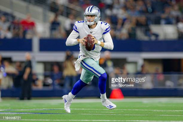 Dallas Cowboys quarterback Mike White rolls out for a pass during the preseason game between the Houston Texans and Dallas Cowboys on August 24, 2019...