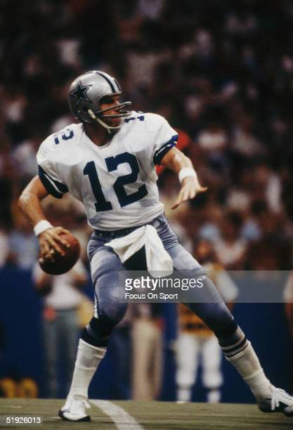 Dallas Cowboys' quarterback Roger Staubach steps back to throw a pass during a game against the New York Giants at Texas Stadium circa 1975 in Irving...