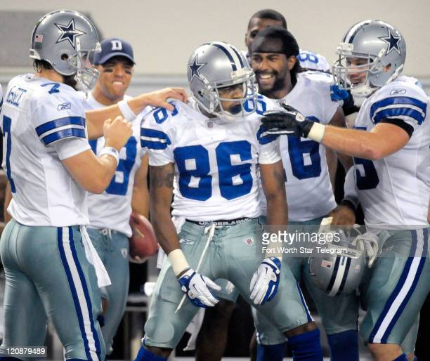 Dallas Cowboys quarterback Stephen McGee left congratulates wide receiver Raymond Radway after Radway brought down a 6yard pass in the third quarter...