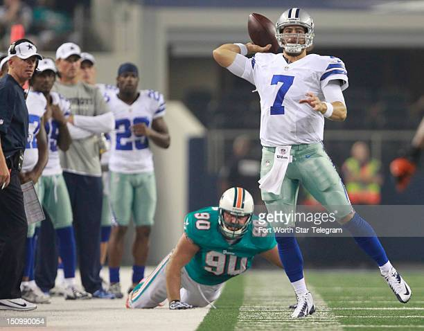 Dallas Cowboys quarterback Stephen McGee scrambles and throws for a completion near the goal line in the second quarter as Miami Dolphins defensive...