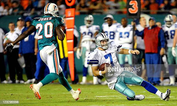 Dallas Cowboys quarterback Stephen McGee slides to the ground as Miami Dolphins' Reshad Jones closes in for the stop during an NFL preseason game at...