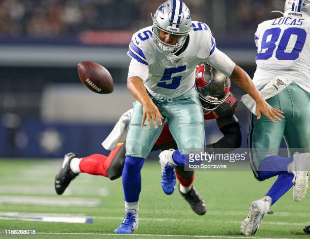 Dallas Cowboys quarterback Taryn Christion fumbles the ball during the preseason game between the Tampa Bay Buccaneers and Dallas Cowboys on August...