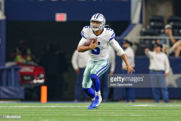 Dallas Cowboys quarterback Taryn Christion runs in the open field during the preseason game between the Tampa Bay Buccaneers and Dallas Cowboys on...