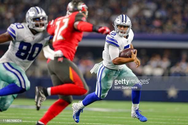 Dallas Cowboys quarterback Taryn Christion runs with the ball during the preseason game between the Tampa Bay Buccaneers and Dallas Cowboys on August...