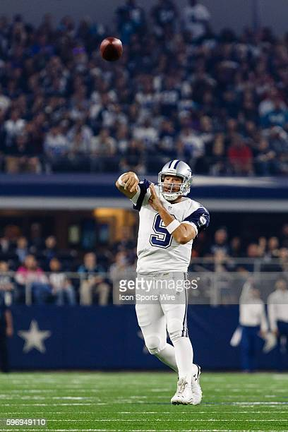 Dallas Cowboys Quarterback Tony Romo [3808] rolls out for a pass during the NFL Thanksgiving game between the Carolina Panthers and the Dallas...