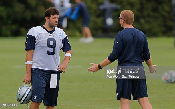Dallas Cowboys quarterback Tony Romo and head coach Jason Garrett talk during an optional Dallas Cowboys practice at Valley Ranch on Wednesday June 1...