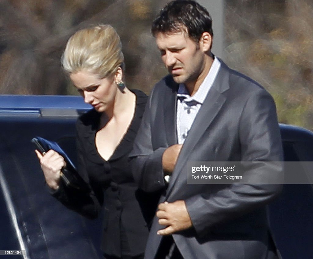 Dallas Cowboys quarterback Tony Romo and his wife, Candice Crawford, arrive for a memorial service for teammateJerry Brown on Tuesday, December 11, 2012, in Dallas, Texas. Brown was killed in a car accident and teammate Josh Brent was charged in the accident.