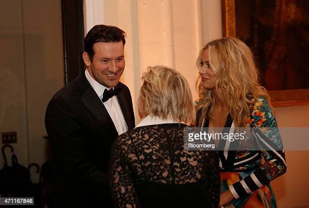 Dallas Cowboys quarterback Tony Romo left and Candice Crawford right attend the Bloomberg Vanity Fair White House Correspondents' Association dinner...