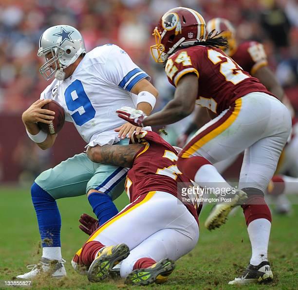 Dallas Cowboys quarterback Tony Romo left is sacked by Washington Redskins defensive end Stephen Bowen center as the Dallas Cowboys defeat the...