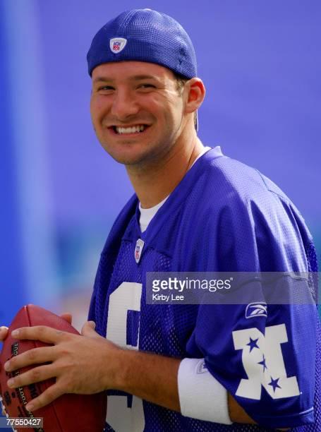 Dallas Cowboys quarterback Tony Romo smiles during NFC practice at NFL Pro Bowl Ohana Day Celebration at Aloha Stadium in Honolulu HI on Friday...
