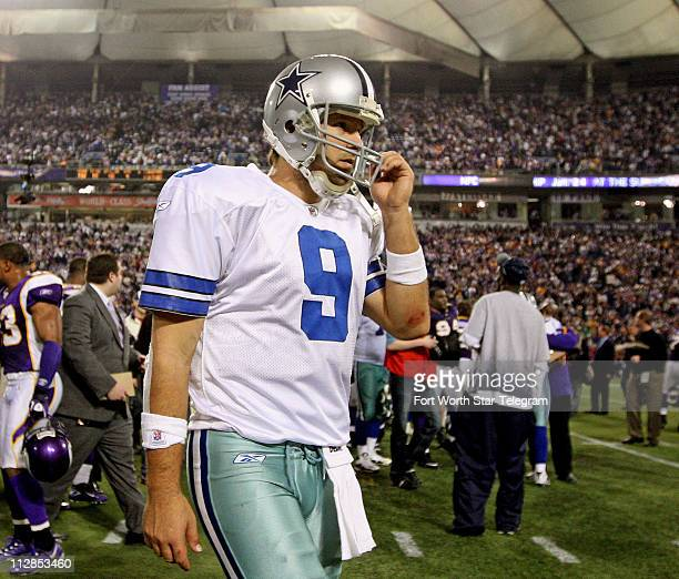 Dallas Cowboys quarterback Tony Romo walks off the field following a 343 defeat to the Minnesota Vikings in an the NFC Divisional Playoff game at the...