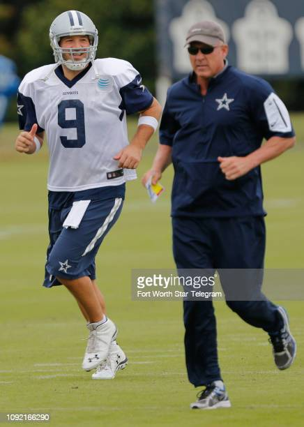 Dallas Cowboys quarterback Tony Romo with quarterback coach Wade Wilson during practice at the team's facility at Valley Ranch in Irving Texas on...