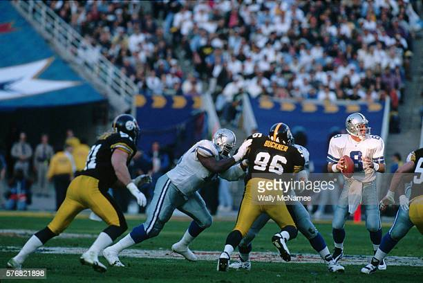Dallas Cowboys quarterback Troy Aikman looks for a receiver during Super Bowl XXX in which the Cowboys defeated the Pittsburgh Steelers