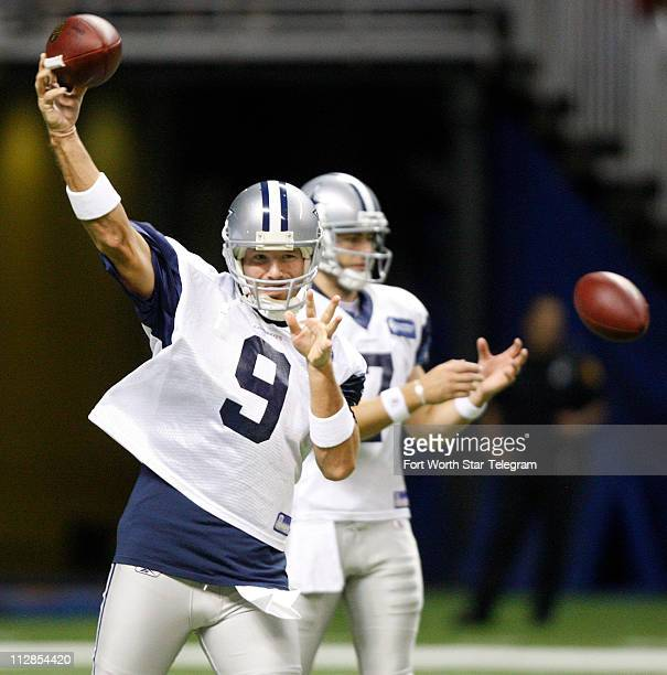 Dallas Cowboys quarterbacks Tony Romo left and Stephen McGee perform passing drills duiring training camp at the Alamodome in San Antonio Texas...