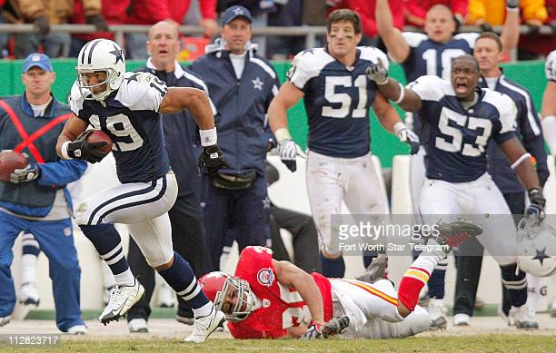 Dallas Cowboys receiver Miles Austin eludes safety Mike Brown to score the winning touchdown in overtime Sunday October 11 at Arrowhead Stadium in...