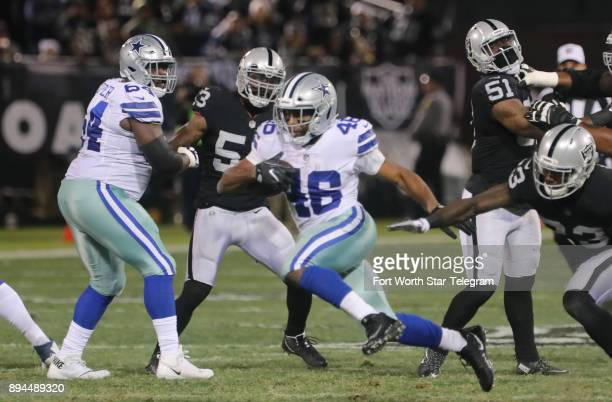 Dallas Cowboys running back Alfred Morris picks up a first down in the first quarter against the Oakland Raiders on Sunday Dec 17 2017 at...