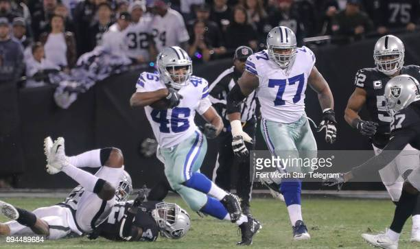 Dallas Cowboys running back Alfred Morris runs for a first down against the Oakland Raiders on Sunday Dec 17 2017 at OaklandAlameda County Coliseum...