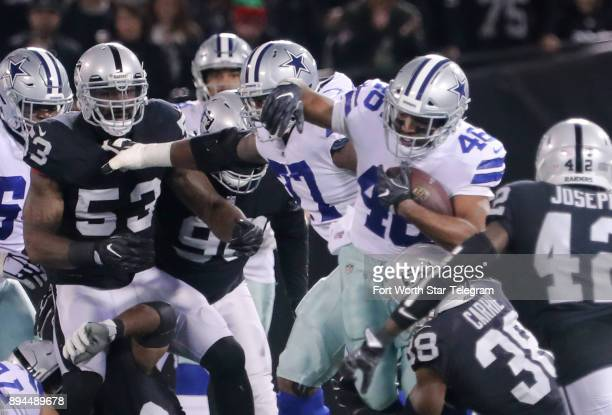 Dallas Cowboys running back Alfred Morris runs for five yards in the first quarter against the Oakland Raiders on Sunday Dec 17 2017 at...
