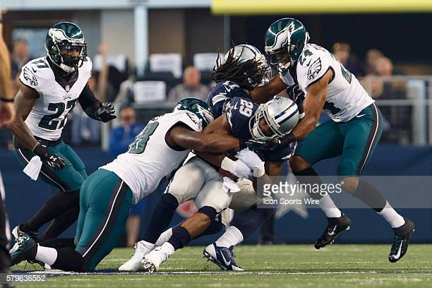 Dallas Cowboys Running Back DeMarco Murray [16636] is wrapped up during the NFL football game between the Philadelphia Eagles and the Dallas Cowboys...