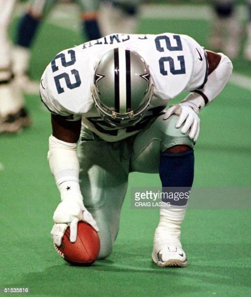 Dallas Cowboys running back Emmitt Smith pauses after scoring a touchdown on a fiveyard run in the first quarter during their NFC wild card game with...