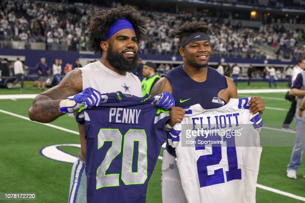 Dallas Cowboys running back Ezekiel Elliott and Seattle Seahawks running back Rashaad Penny exchange jerseys after the NFC wildcard playoff game...
