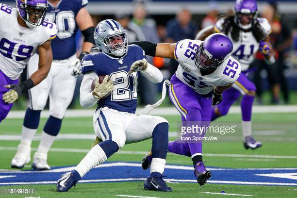 Dallas Cowboys Running Back Ezekiel Elliott attempts to spin out of a tackle by Minnesota Vikings Linebacker Anthony Barr during the game between the...