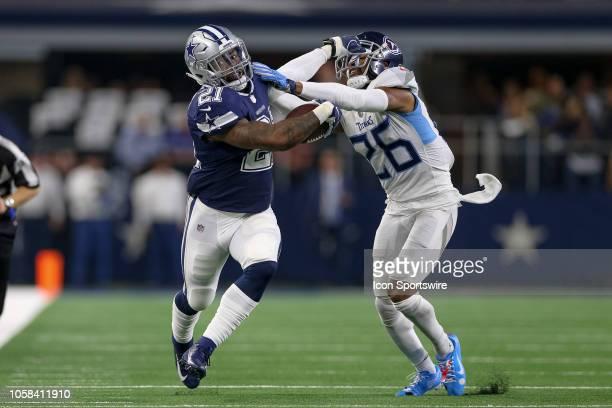 Dallas Cowboys running back Ezekiel Elliott attempts to stiffarm Tennessee Titans cornerback Logan Ryan during the game between the Tennessee Titans...