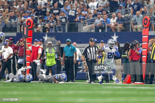 Dallas Cowboys running back Ezekiel Elliott breaks free from Detroit Lions cornerback Quandre Diggs and defensive back Nevin Lawson during the game...