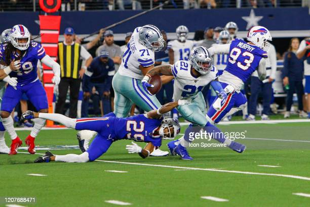 Dallas Cowboys Running Back Ezekiel Elliott breaks free of a tackle attempt by Buffalo Bills Cornerback Kevin Johnson during the game between the...
