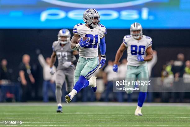Dallas Cowboys running back Ezekiel Elliott breaks through the line for a long gain during the game between the Detroit Lions and Dallas Cowboys on...