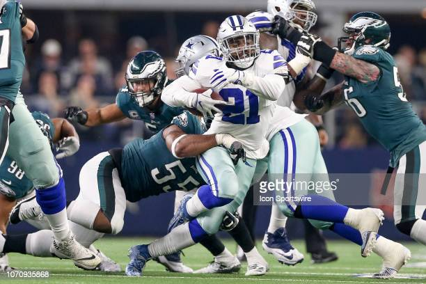Dallas Cowboys Running Back Ezekiel Elliott breaks through the line with Philadelphia Eagles Defensive End Brandon Graham tackling from behind during...
