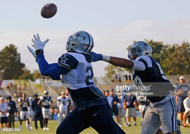 Dallas Cowboys running back Ezekiel Elliott catches a pass in the end zone over outside linebacker Damien Wilson during an afternoon practice at...