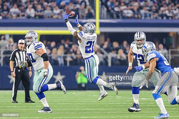 Dallas Cowboys running back Ezekiel Elliott catches a screen pass with guard Zack Martin and center Travis Frederick leading the way during the game...