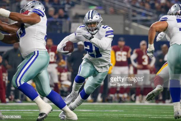 Dallas Cowboys Running Back Ezekiel Elliott cuts back through a hole during the Thanksgiving Day game between the Washington Redskins and Dallas...