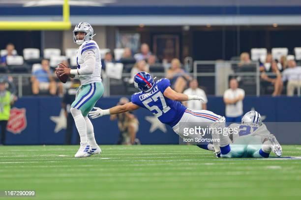 Dallas Cowboys Running Back Ezekiel Elliott is called for holding as New York Giants Linebacker Ryan Connelly rushes Quarterback Dak Prescott during...