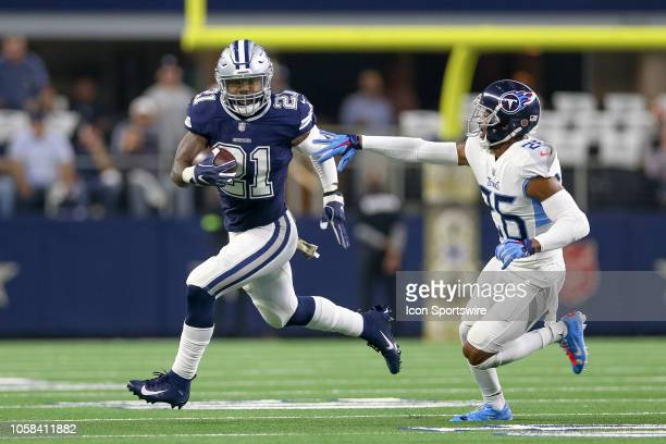 Dallas Cowboys running back Ezekiel Elliott is chased by Tennessee Titans cornerback Logan Ryan during the game between the Tennessee Titans and...