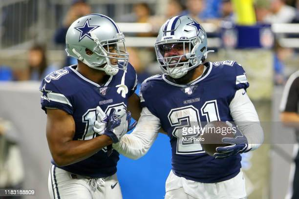 Dallas Cowboys running back Ezekiel Elliott is congratulated by Dallas Cowboys wide receiver Amari Cooper after making a touchdown during the second...