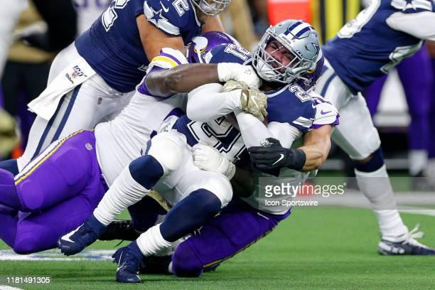 Dallas Cowboys Running Back Ezekiel Elliott is gang tackled during the game between the Minnesota Vikings and Dallas Cowboys on November 10, 2019 at...