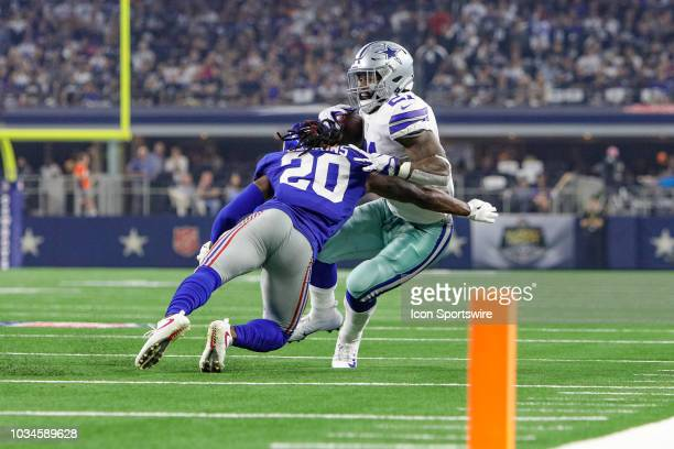 Dallas Cowboys running back Ezekiel Elliott is hit by New York Giants defensive back Janoris Jenkins during the game between the New York Giants and...