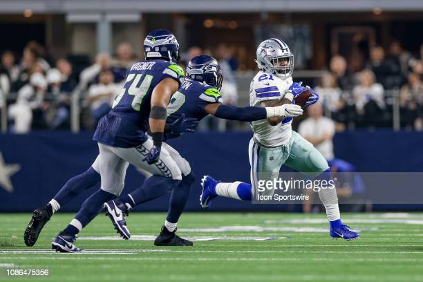 Dallas Cowboys running back Ezekiel Elliott is pursued by Seattle Seahawks linebacker Jake Martin and middle linebacker Bobby Wagner during the NFC...