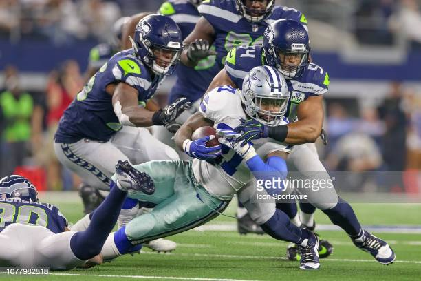 Dallas Cowboys running back Ezekiel Elliott is stopped short of a first down by Seattle Seahawks middle linebacker Bobby Wagner during the NFC...