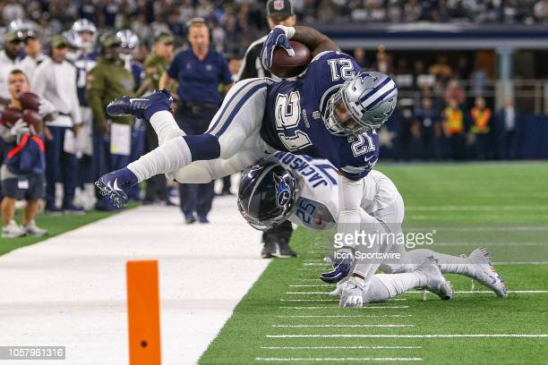 Dallas Cowboys running back Ezekiel Elliott is tackled by Tennessee Titans cornerback Adoree' Jackson during the game between the Tennessee Titans...