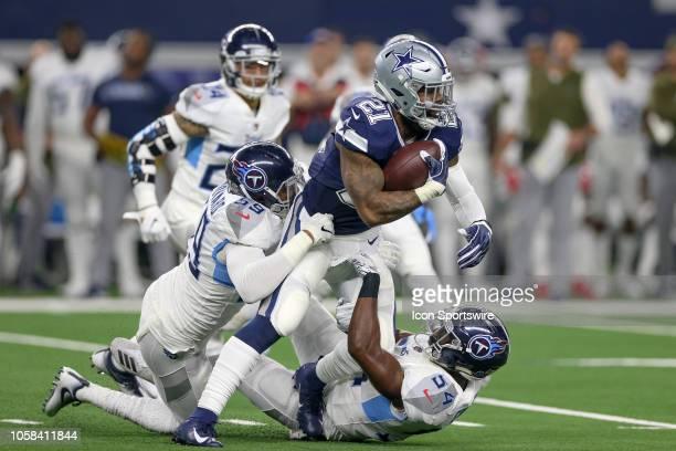 Dallas Cowboys running back Ezekiel Elliott is tackled by Tennessee Titans inside linebacker Rashaan Evans and inside linebacker Wesley Woodyard...