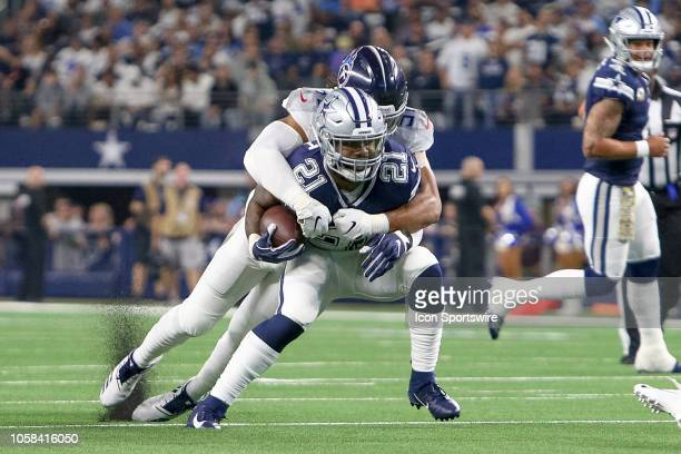 Dallas Cowboys running back Ezekiel Elliott is tackled from behind by Tennessee Titans linebacker Sharif Finch during the game between the Tennessee...