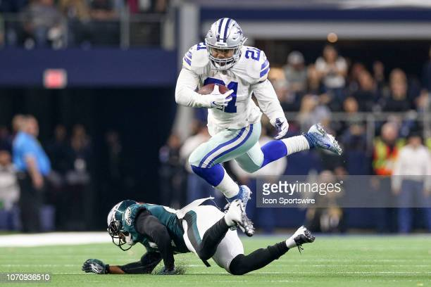 Dallas Cowboys Running Back Ezekiel Elliott leaps over a defender during the game between the Philadelphia Eagles and Dallas Cowboys on December 9...